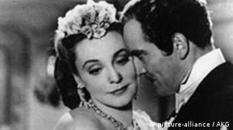 Zarah Leander with a leading man in film still