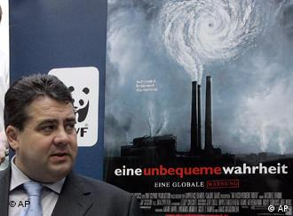 German Environment Minister Gabriel in front of a poster for Al Gore's film An Inconvenient Truth