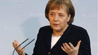 Chancellor Angela Merkel speaking at a press conference