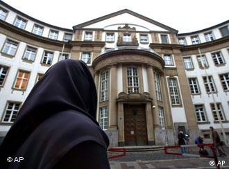 Woman in headscarf before court
