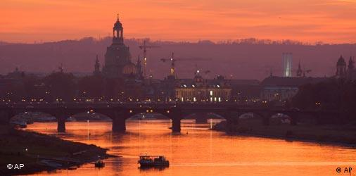 Dresden bathed in reddish light at sunset with backdrop of the famous Frauenkirche (Church of Our Lady) in background