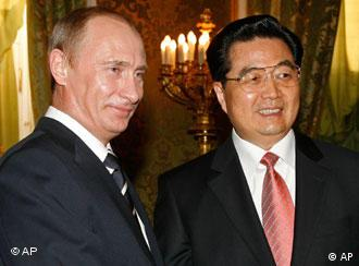 Russian President Vladimir Putin, left, greets Chinese leader Hu Jintao during their meeting in the Kremlin in Moscow, Monday, March 26, 2007. The presidents of Russia and China on Monday called on Iran to fulfill the U.N. Security Council's demands over its disputed atomic program, a day after the Islamic republic announced it was partially suspending cooperation with the U.N. nuclear watchdog. (AP Photo/Misha Japaridze)