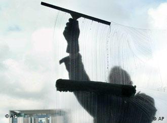 A window washer cleans the Federal Chancellory in Berlin