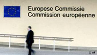 A man walks by European Commission headquarters in Brussels