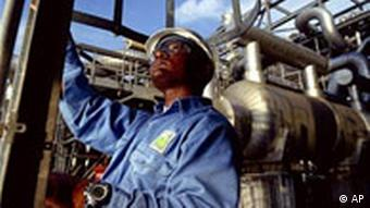 A Shell oil company worker on an offshore oil platform in the Niger Delta, Nigeria.
