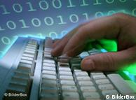 Hands at a keyboard, background of binary code