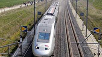 A TGV in France alongside an empty set of rails