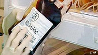 ** FILE ** A civil guard looks at a frozen bag of blood during a raid in Madrid, in this photo realeased by the Civil Guard on Wednesday, May 24, 2006. According to German TV reports on Tuesday, April 3, 2007, citing a public prosecutor investigating the doping allegations against Ullrich, the DNA of Jan Ullrich matches without any doubt with the DNA of blood, that has been found in the Operation Puerto investigation into doping in cycling. The investigation implicated more than 50 cyclists and led to pre-race favorites Jan Ullrich and Ivan Basso and seven others riders being excluded from last year's Tour de France. (AP Photo/Spanish Civil Guard)
