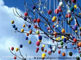 Colorful eggs hang from a tree