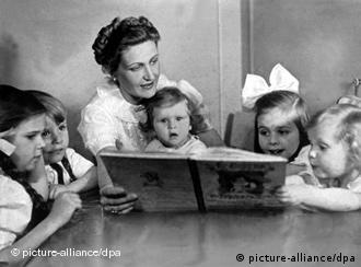 Magda Goebbels reading a book to her children