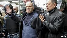 Riot police officers detain Russian opposition leader Garry Kasparov, center, the former world chess champion, during a protest in Moscow, Saturday, April 14, 2007. Police detained Russian opposition leader Garry Kasparov, the former world chess champion, and at least 100 other activists Saturday as they gathered for a forbidden anti-Kremlin demonstration in central Moscow. (AP Photo/Vladimir Suvorov, Izvestia)