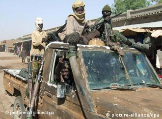 A photograph made available Tuesday 10 April 2007, showing Sudanese Liberation Army (SLA) rebels drive through Adre on a battlewagon in eastern Chad, on 23 March 2007