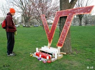 Virginia Tech student Jeff Graham visits a makeshift memorial to the 32 slain students and others on the campus of the school in Blacksburg, Va., Tuesday, April 17, 2007