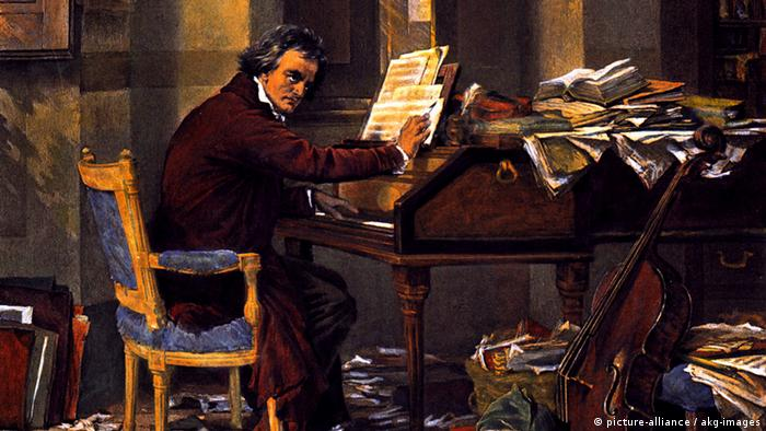 Ludwig van Beethoven sitting at a piano composing (Photo: picture-alliance / akg-images)