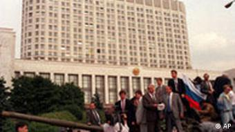 Boris Yeltsin speaking on top of a tank in front of the Russian parliament