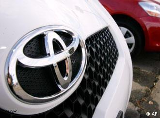 The company logo shines off the nose of an unsold 2007 Yaris hatchback at a Toyota dealership in Boulder, Colo., on Sunday, Feb. 18, 2007. Toyota Motor Sales USA Inc. said Thursday,March 1, 2007 its February U.S. auto sales rose, spurred by brisk demand for its passenger cars. (AP Photo/David Zalubowski)