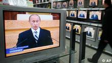 A man walks along a display in a Moscow shop during annual state of the nation address, delivered by President Vladimir Putin to the Federation Council, the upper house of parliament, Thursday, April 26, 2007. President Vladimir Putin on Thursday made his clearest rejection yet of speculation that he would try to seek a third term, but gave no hint in his state of the nation address as to whom he sees as his preferred successor. (AP Photo/Misha Japaridze)