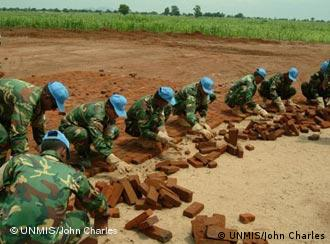 Peacekeepers from Bangladesh doing road construction work in Juba, Sudan. UNMIS Photo/John Charles, 18 July 2005.