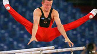 Fabian Hambuechen of Germany performs on the parallel bars