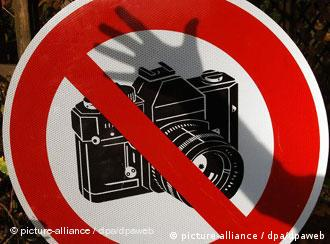 A forbidden sign showing a camera struck through by a line