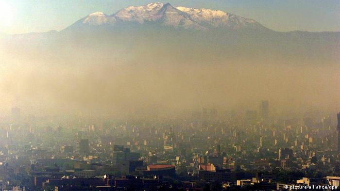 Smog over Mexico city with volcano in the background