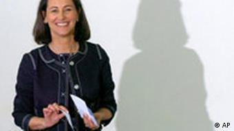 Segolene Royal standing in a suit in front of a white background