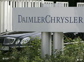 A Mercedes-Benz limousine leaves the maingate of the DaimlerChrysler headquarters in Stuttgart, Germany