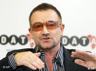 People expect Germans to keep their promises, Bono said Tuesday in Berlin
