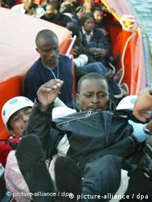 North African refugees are rescued by European coast guards near Spain