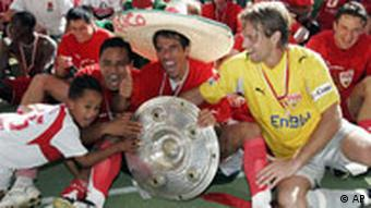 Stuttgart's Ricardo Osorio from Mexico, countryman Pavel Pardo and Timo Hildebrand, from left to right, celebrate with the German soccer championship trophy