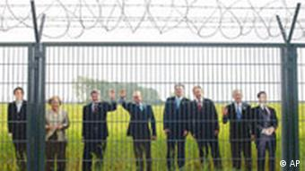 Cardboard cut-outs of the G8 delegates behind the security fence at Heiligendamm