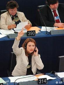 Greek European Parliament member Katerina Batzeli voted on the mobile regulatory measure in 2007 with a phone in hand