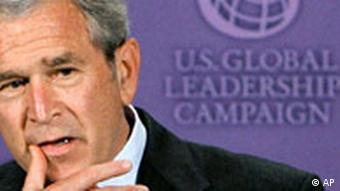 US Persident Bush in front of a logo for the US Global Leadership Campaign