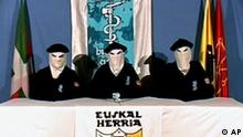 ** FILE ** This video frame, seen in this March 22, 2006 file photo, which was released by the Basque separatist group ETA, shows three unidentified people with their faces covered, wearing Basque berets and seated at a table in front of an ETA flag with a Basque Country symbol in foreground. The video played on Spanish national television and distributed to local Basque television and newspaper outlets declared a permanent cease-fire. ETA announced in the early hours of Tuesday June 5, 2007 that the ceasefire was over. (AP Photo/Basque Television) ** THE ASSOCIATED PRESS HAS NO WAY OF INDEPENDENTLY VERIFYING THE CONTENT, LOCATION OR DATE OF THIS VIDEO **