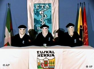 Three masked men appear in front of ETA banners in a video released in 2006