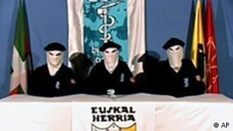 Pictures of three masked men sitting at a table