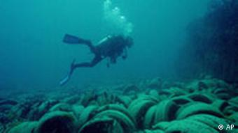 Scuba diver swimming by an artificial reef