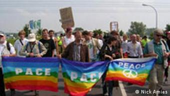 A large group of G8 protesters marching in the German city of Heiligendamm