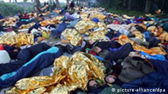 Protestors in sleeping bags on the road leading to the G8 summit