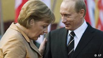 German Chancellor Angela Merkel. left, chats with Russian President Vladimir Putin