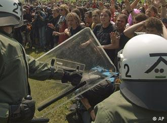 Anti G8 demonstrators face federal German riot police in Hinter Bollhagen, Germany, Thursday, June 7, 2007