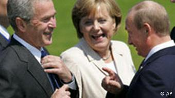 US President George W. Bush, German Chancellor Angela Merkel and Russian President Vladimir Putin, right share a laugh during a photo call at the G8 summit in Heiligendamm, on June 8, 2007.