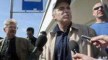 Russian opposition leader Garry Kasparov, second right, a former world chess champion, speaks to the media outside the airport just after his arrival in St. Petersburg, Russia, Saturday, June 9, 2007, as Eduard Limonov, the leader of the banned radical National Bolshevik party, second left, looks on. (AP Photo/Sergey Ponomarev)