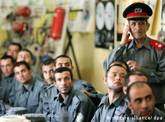Police sit at a table in a training session in Kabul, Afghanistan