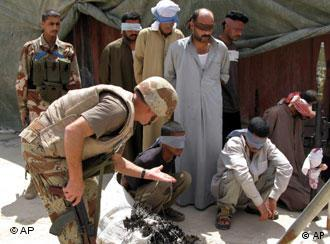 ** FILE ** Suspected terrorists are interrogated by Iraqi troops at a Iraqi military base in Baqouba, 60 kilometers (35 miles) northeast of Baghdad, Iraq, in this May 7, 2007 file photo. Six Iraqis believed to be linked with al-Qaida were detained in a raid near Baqouba. Al-Qaida is the group that gets routinely tagged Public Enemy No. 1 by the Americans. Nine out of 10 times, when it names a foe it faces, the U.S. military names the group called al-Qaida in Iraq. (AP Photo/Adem Hadei, File )