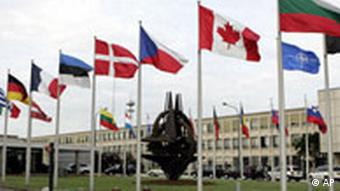 National flags flying outside NATO headquarters in Brussels