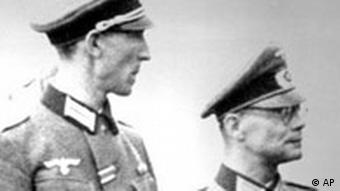 The photo shows former United Nations Secretary General Kurt Waldheim, center in Wehrmacht uniform at a meeting on May 22, 1943, at an airstrip in Podgorica, Yugoslavia.