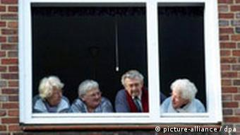 Old people looking out of a window