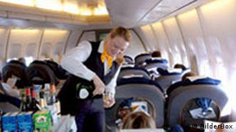 A stewardess gives drinks to passengers