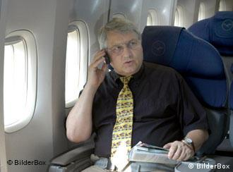 Man in plane on phone